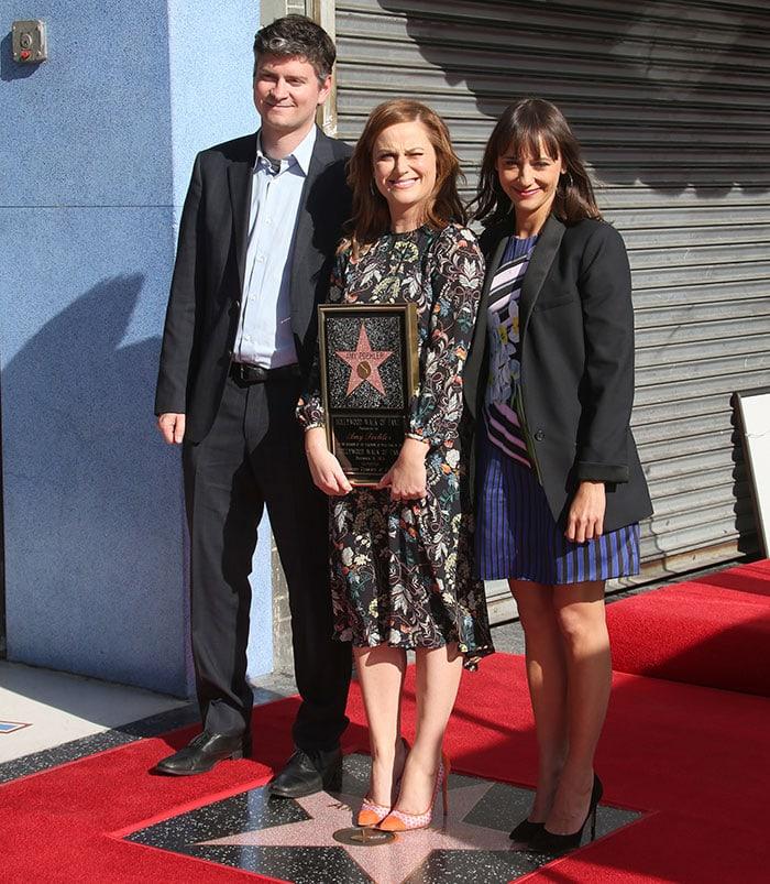 Amy Poehler poses on her Hollywood Walk of Fame star with Michael Schur and Rashida Jones