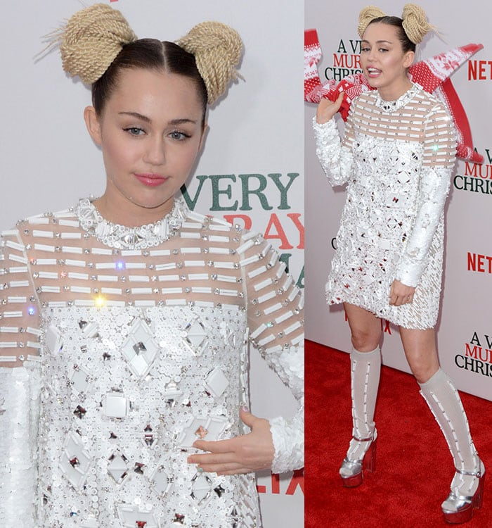 Miley Cyrus finishes off her tame ensemble with a pair of rope braid buns