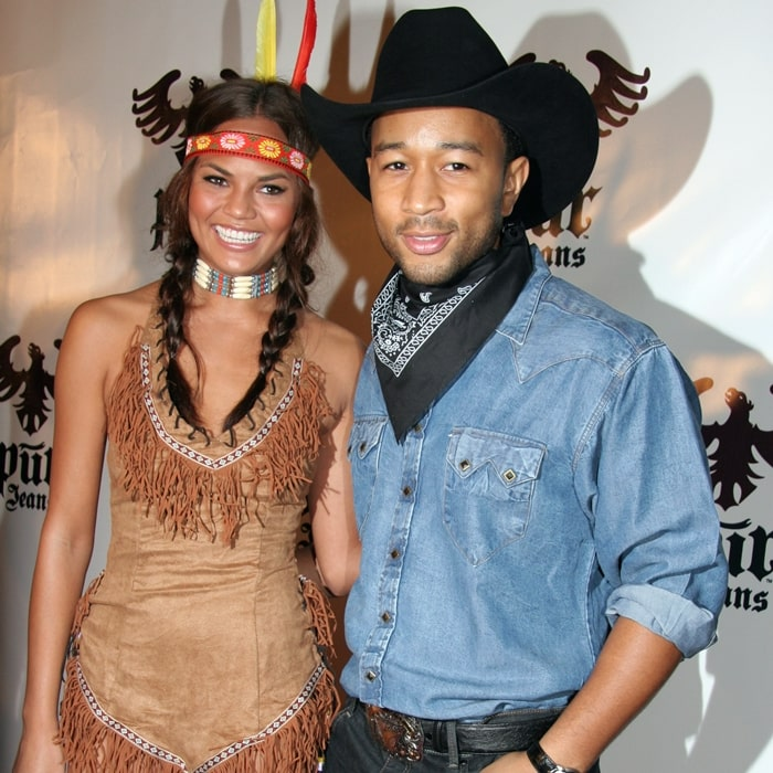Musician John Legend (R) arrives with girlfriend Chrissy Teigen at the Pur Jeans Halloween Bash