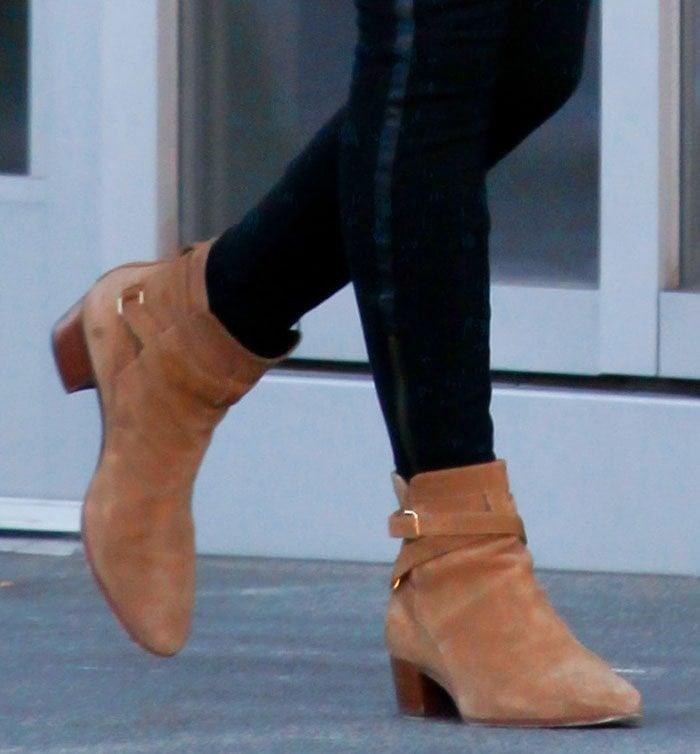 Nicky Hilton's feet in Saint Laurent's Jodphur booties