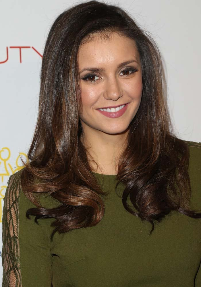 """Nina Dobrev wears her dark hair down and curled for the second edition launch of """"The Beauty Book For Brain Cancer"""""""