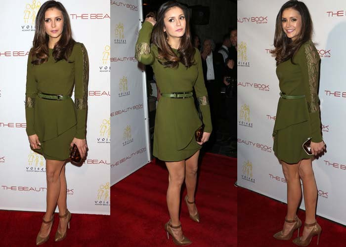 Nina Dobrev poses on the red carpet in a knee-length dress from Elie Saab