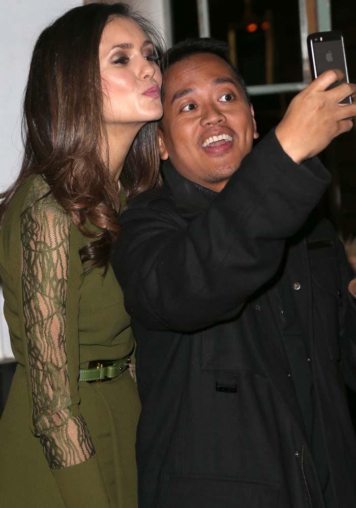 Nina Dobrev poses for a selfie