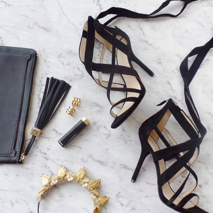 Crossover straps and a dramatic tie detail elevate a svelte stiletto sandal from Nine West cast in lush suede
