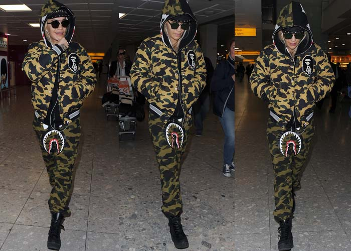 Rita Ora wears an ensemble from A Bathing Ape's 1st Camo line at the London airport