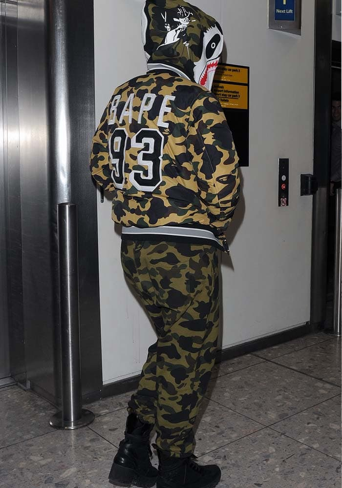 "Rita Ora wears an all-camouflage outfit with a pair of ""Palm Canyon Desert"" boots at London's Heathrow Airport"