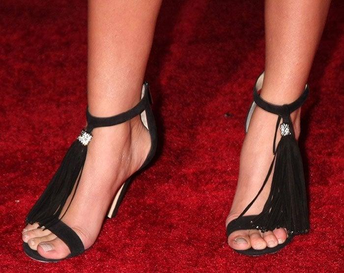 Sarah Hyland's shoes featurelong crystal-embellished tassels