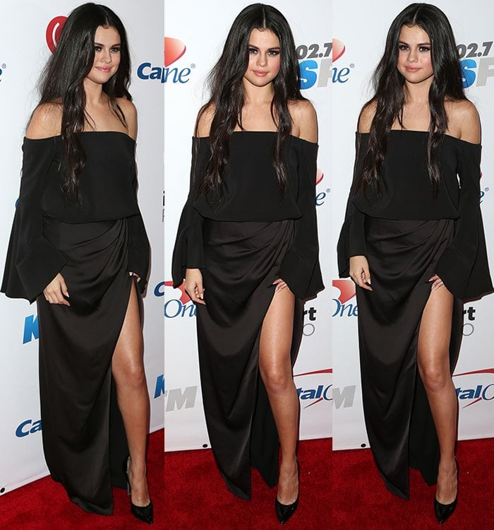 Selena Gomez shows off a pair of Casadei sandals underneath her black dress