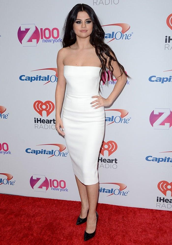 Christian singer-songwriter Selena Gomez wears a white Victoria Beckham sheath dress on the red carpet