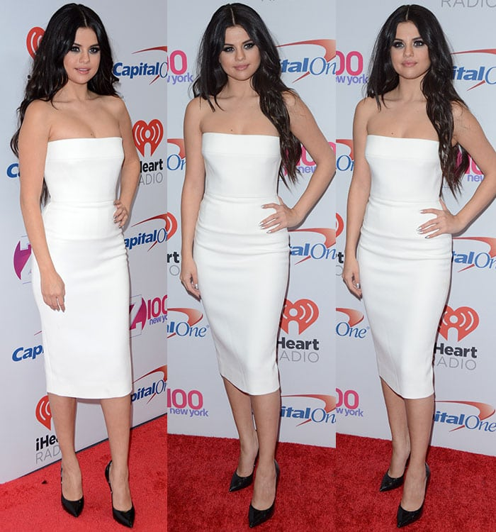 Selena Gomez pairs a white sheath dress with a pair of black pumps