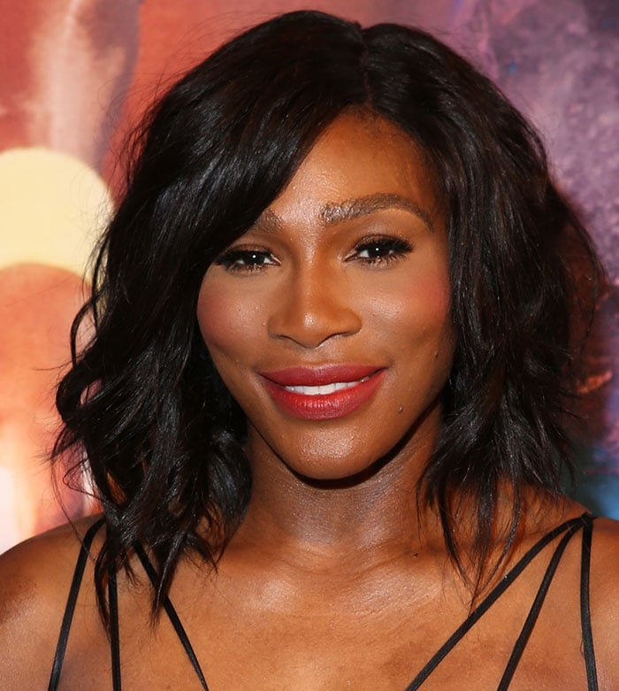 Serena wore her short dark locks in tousled waves and added a pop of color to the look with red lipstick