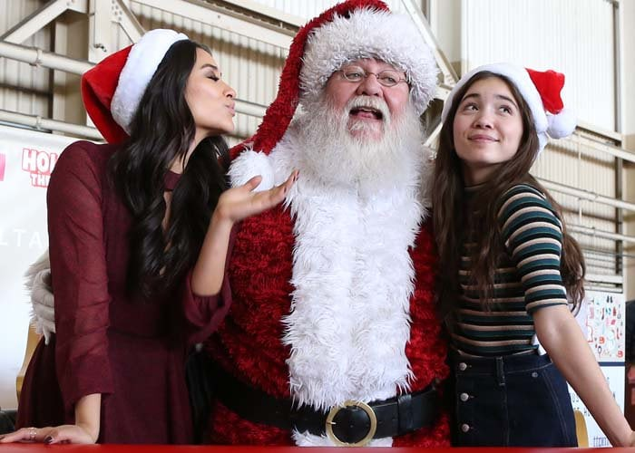 Shay Mitchell and Rowan Blanchard help cheer up kids at this year's Holiday in the Hangar by Delta Airlines in Los Angeles on December 2, 2015