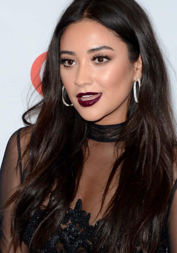 Shay Mitchell wears her dark hair down at iHeartRadio's 2015 Jingle Ball