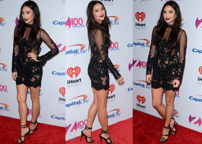 Shay Mitchell wears a lace-and-mesh dress by Oglia-Loro on the red carpet of the Jingle Ball