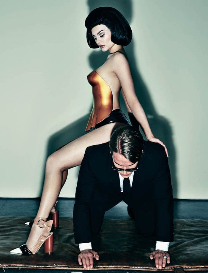 Kylie Jenner wears a pair of Christian Dior pumps as she straddles a man for a photoshoot