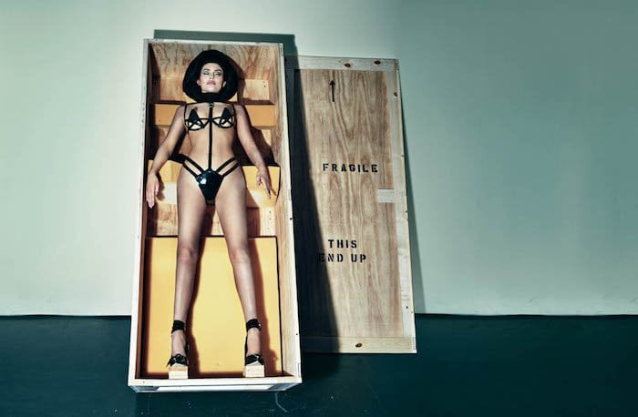 Kylie Jenner wears a Chromat cutout bra and a Dawnamatrix harness for a photoshoot
