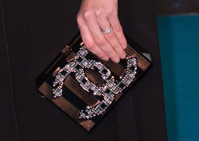 Kaya Scodelario shows off her engagement ring and a Chanel clutch