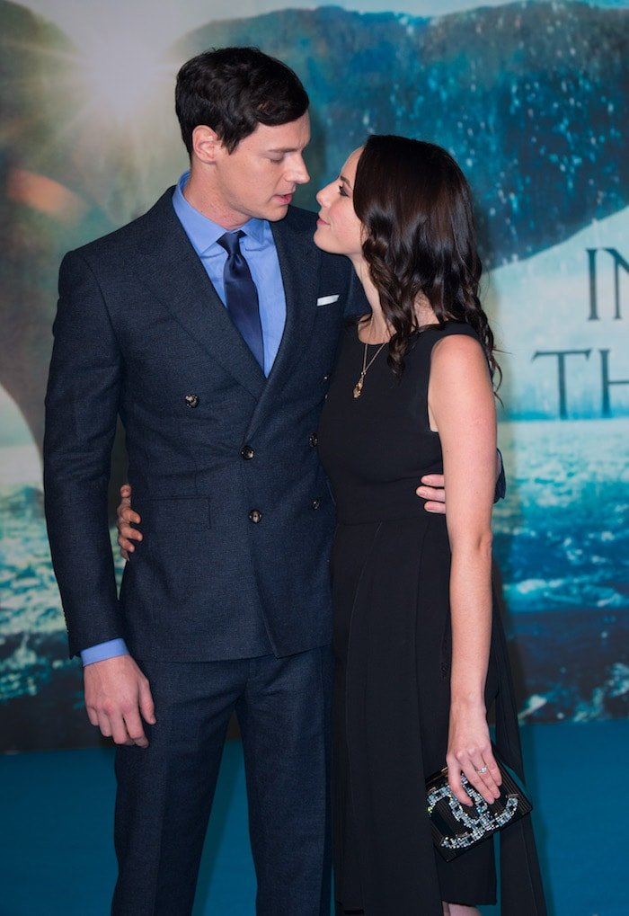 "Ben Walker and Kaya Scodelario pose for photos at the UK premiere of ""In the Heart of the Sea"""