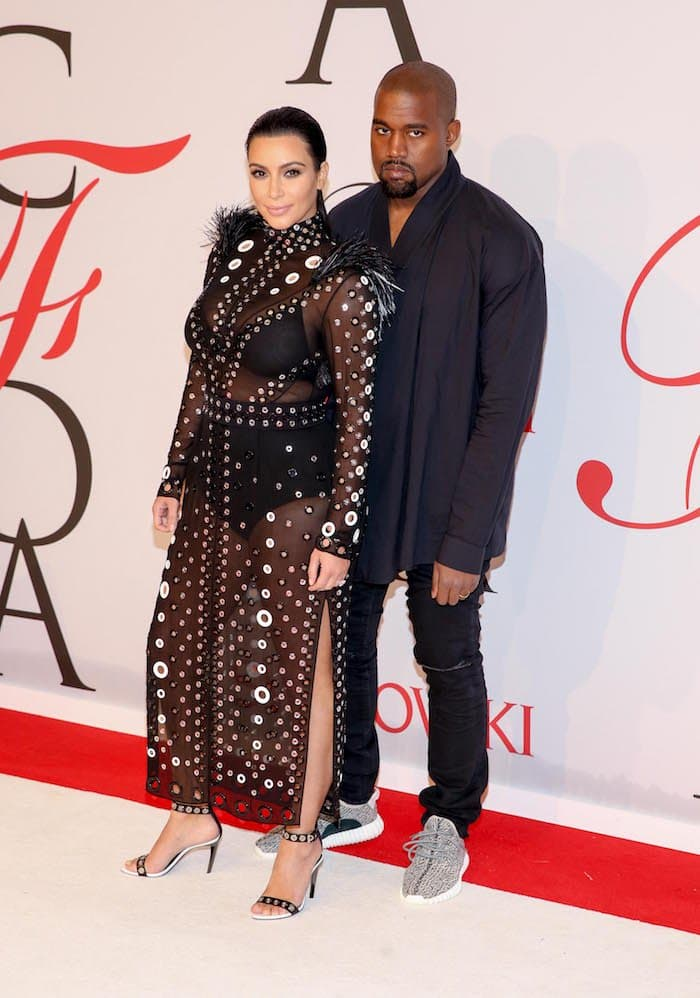 A pregnant Kim Kardashian attends the 2015 CFDA Fashion Awards in custom Proenza Shouler with husband Kanye West