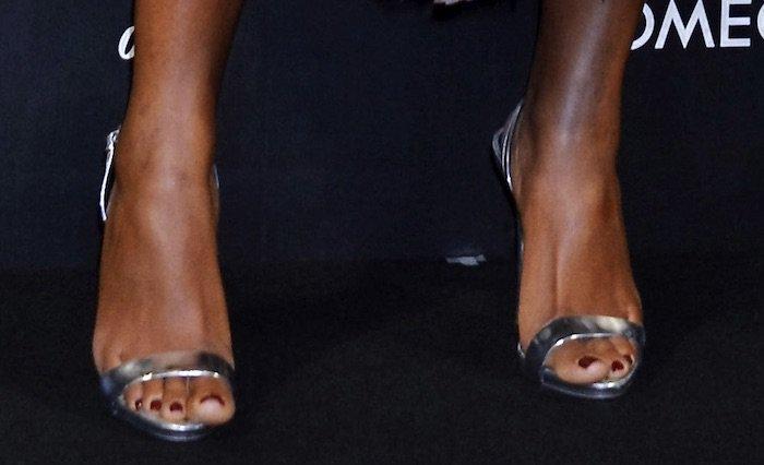 Naomie Harris wearing Giuseppe Zanotti slingback sandals in silver