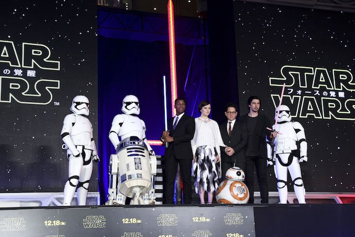 """The cast of """"Star Wars: The Force Awakens"""" bring out their lightsabers for a fan event in Japan"""