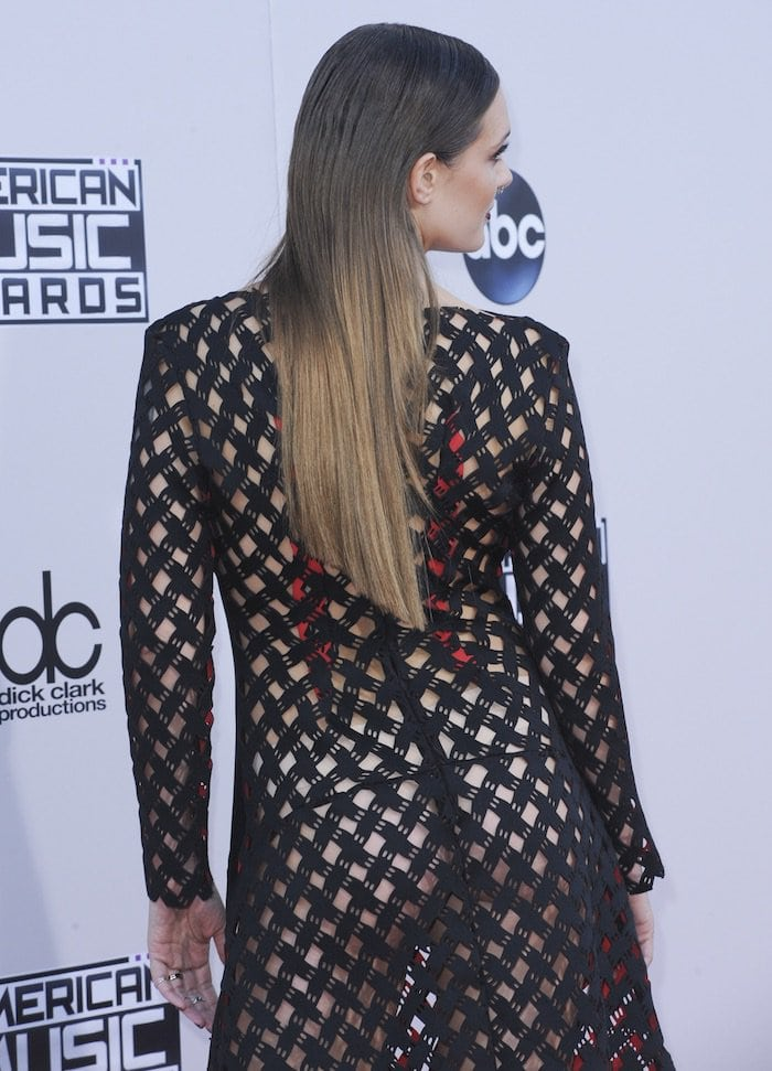 Tove Lo shows off her backside in a fishnet dress from Lamija Suljevic