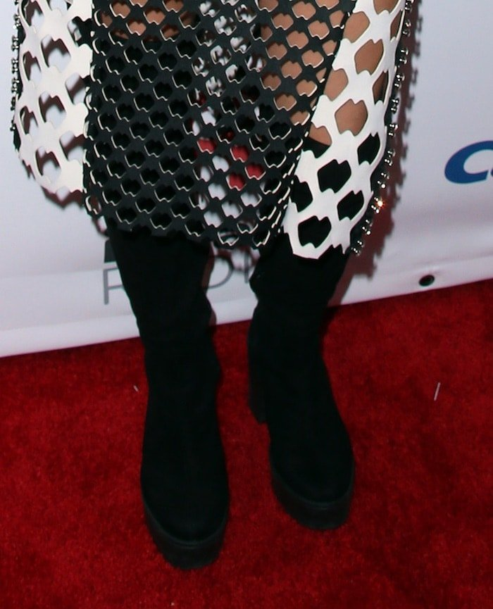 Tove Lo styled her Lamija Suljevic dress with black boots