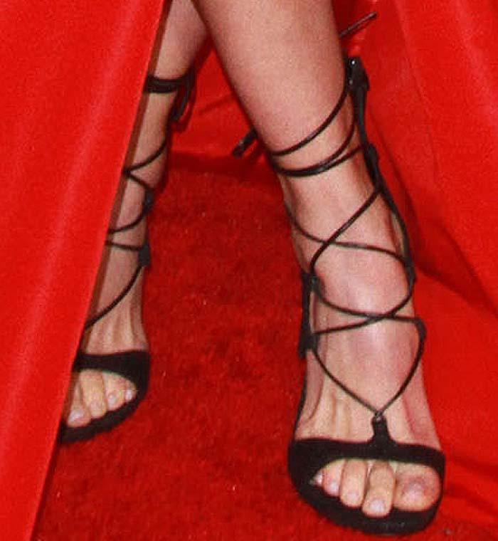 Abigail Spencer's feet in strappy black Stuart Weitzman sandals