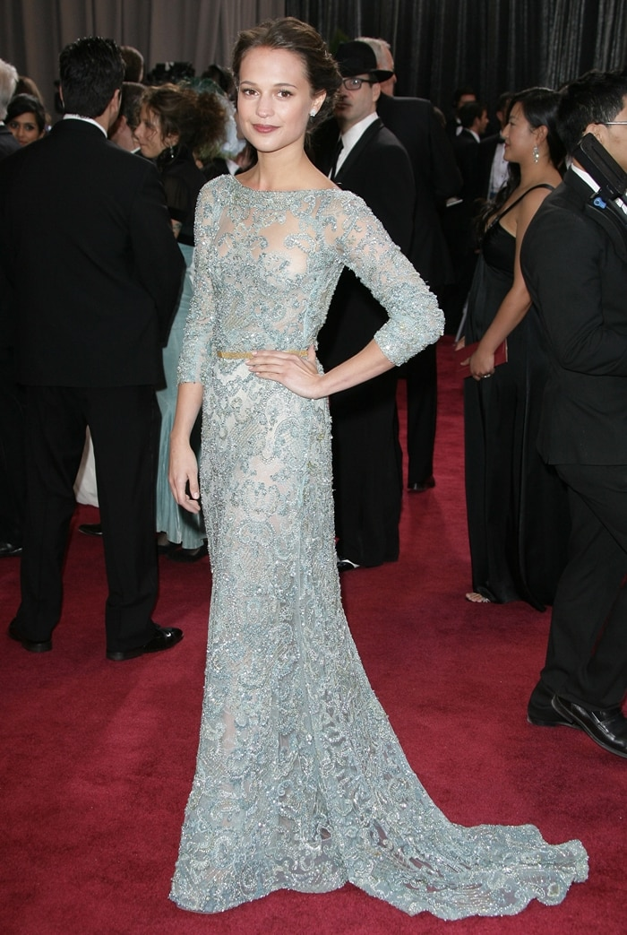 Actress Alicia Vikander wears an embroidered Elie Saab Fall 2012 Couture dress
