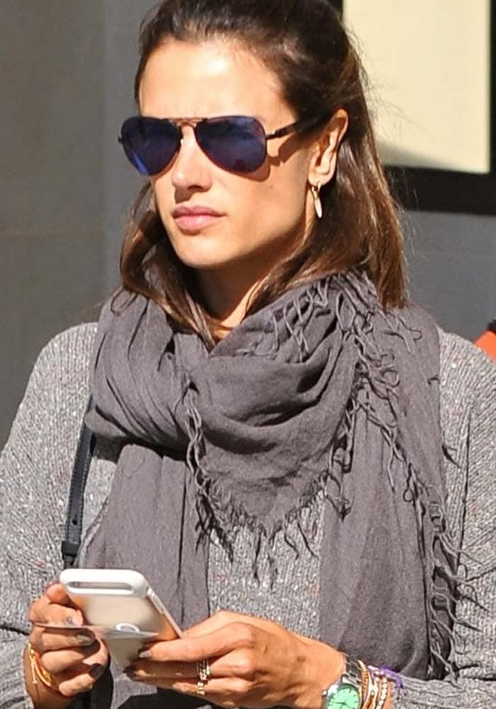 Alessandra Ambrosio wearing sunglasses and a long scarf