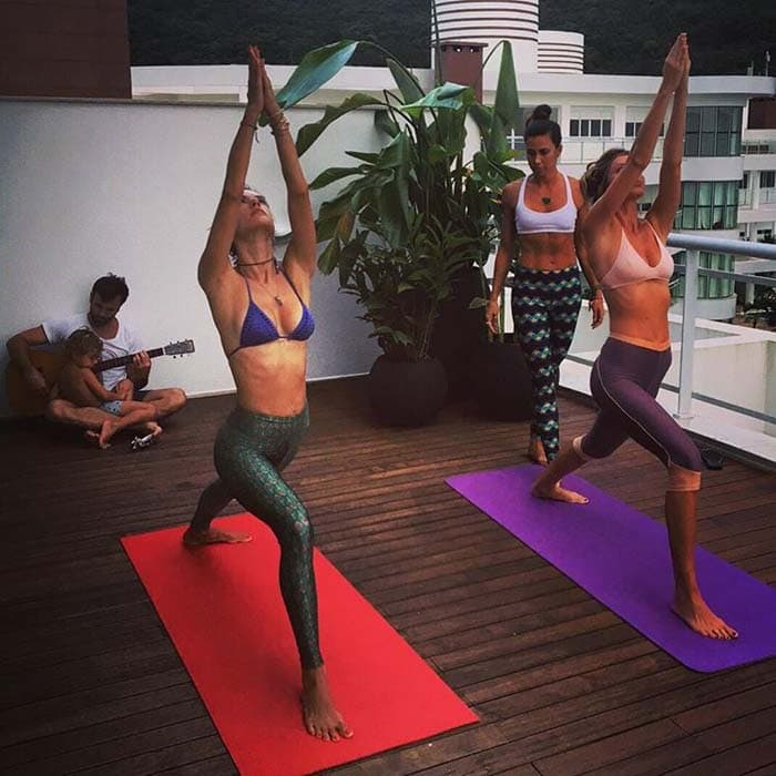 Alessandra Ambrosio shares a photo of her doing yoga while on vacation on her Instagram