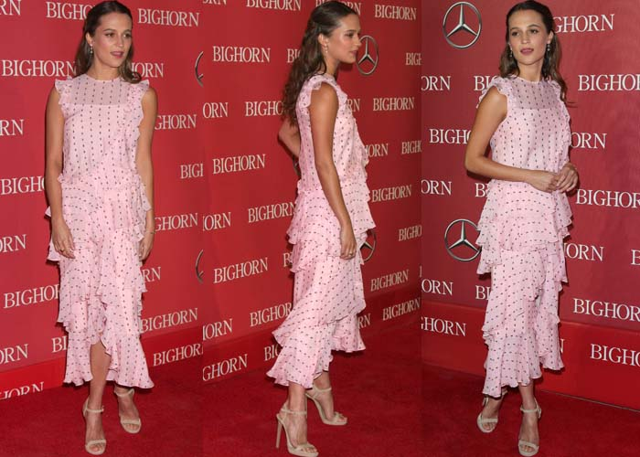 Alicia Vikander wears a ruffle-laden dress from Erdem on the red carpet