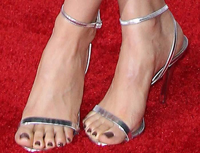 Alison Brie's feet in silver Tamara Mellon sandals