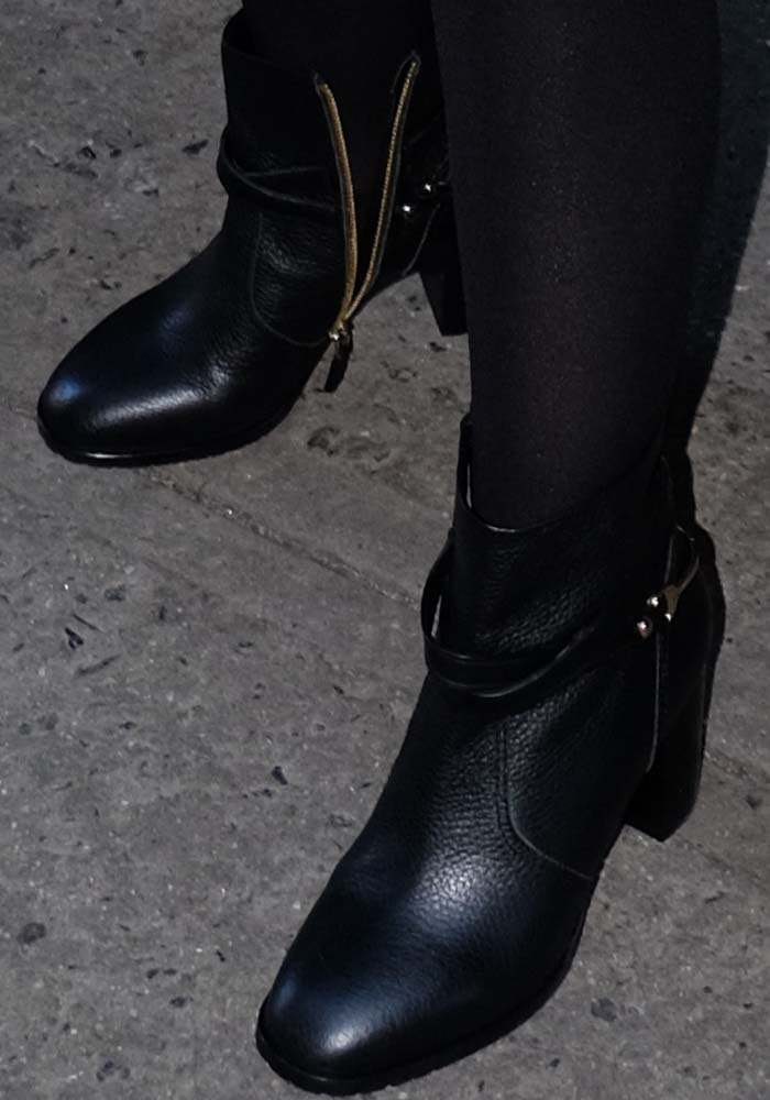 Alyssa Milano wears a pair of black zip-up ankle boots from L.K. Bennett