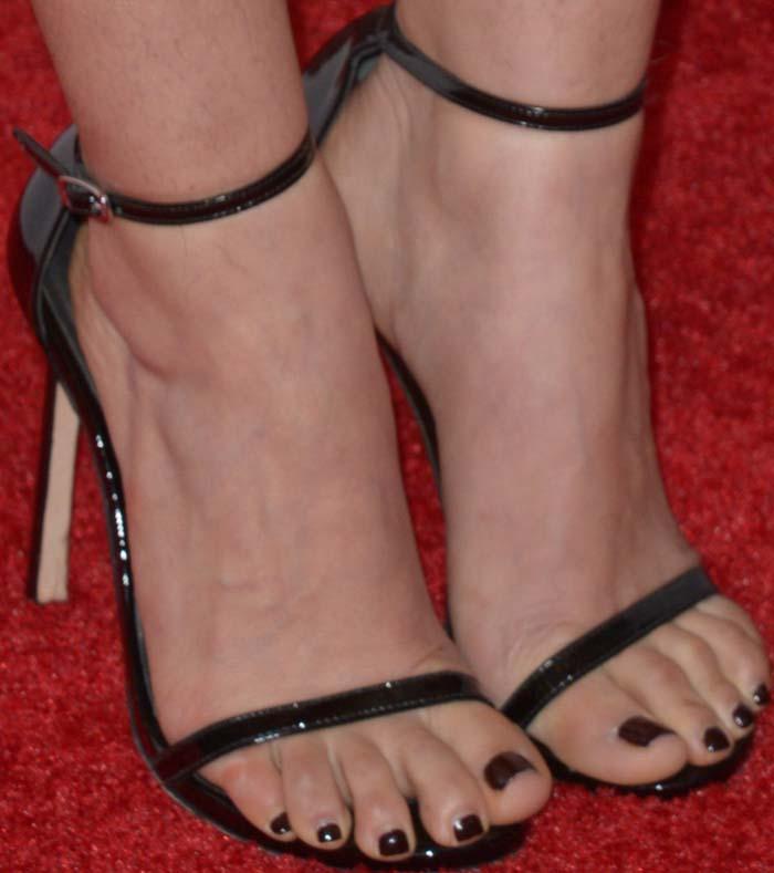 America Ferrera's feet in strappy Stuart Weitzman sandals