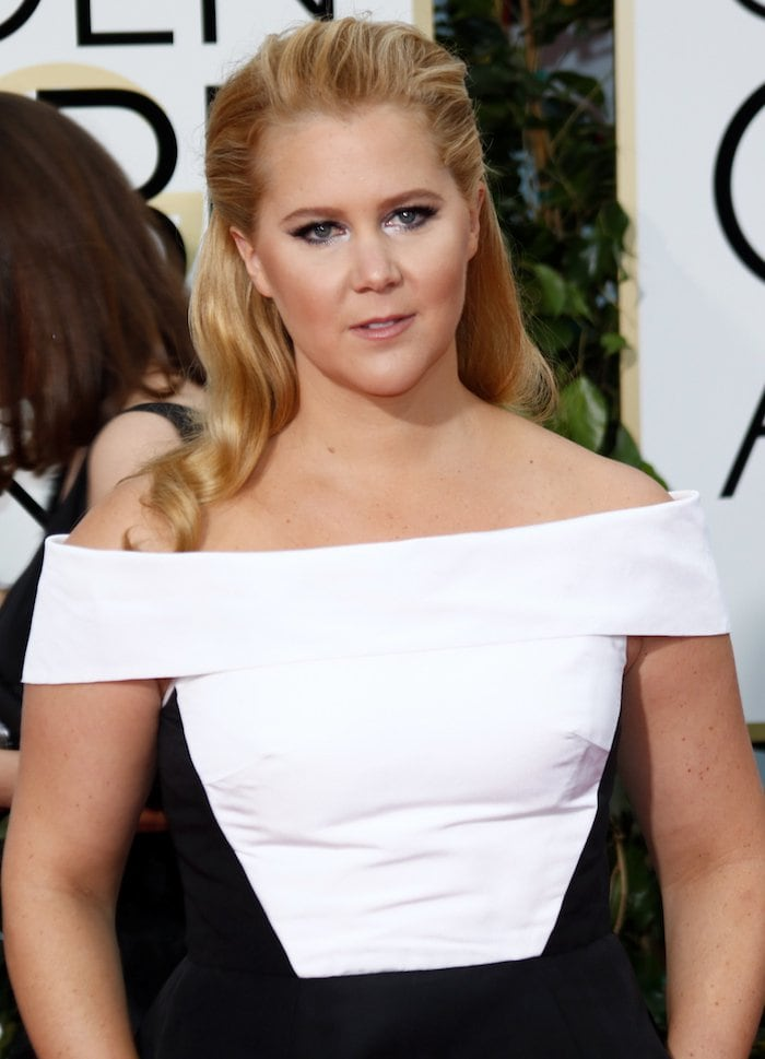 Amy Schumer wears her blonde hair half up and half down at the 73rd Annual Golden Globe Awards