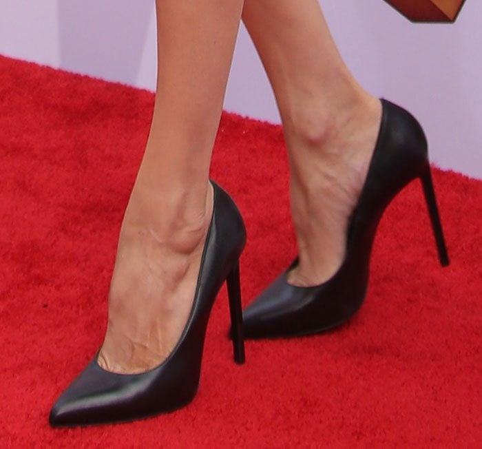 Angelina Jolie showing off her feet in Saint Laurent pumps