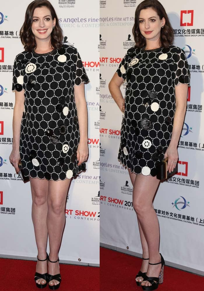 Anne Hathaway flaunts her legs at the Los Angeles Fine Art Show's 2016 opening night party for St. Jude Children's Research Hospital