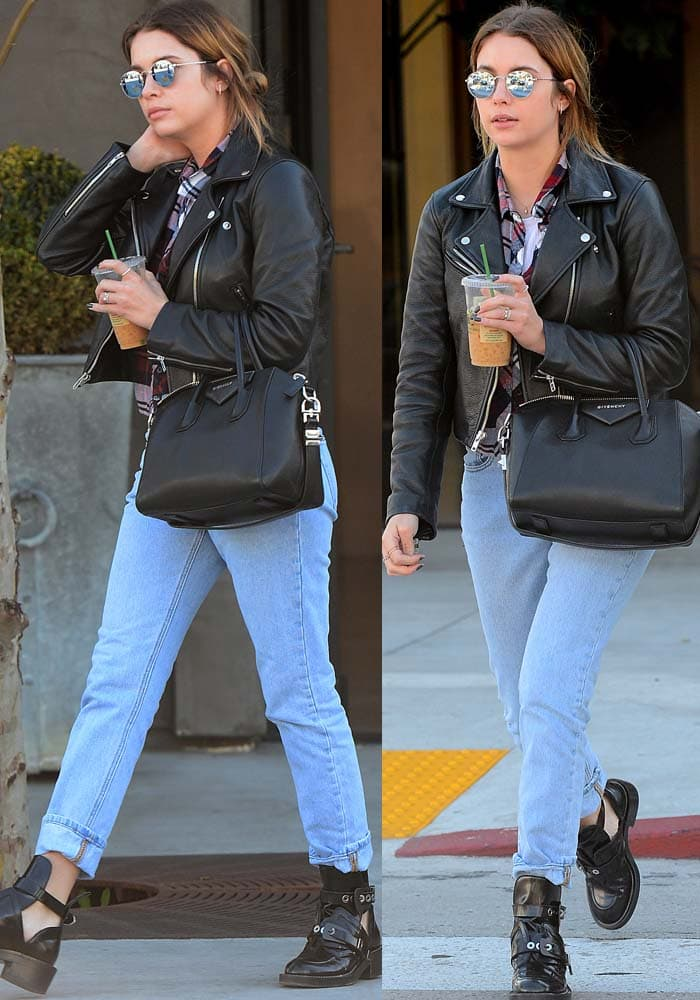 Ashley Benson wears a leather jacket and baggy jeans as she leaves a coffee shop