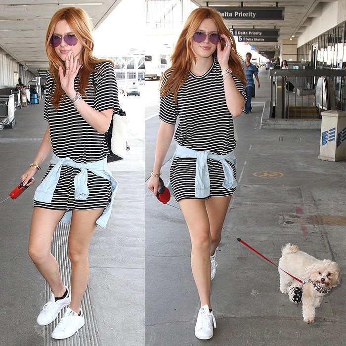 Bella Thorne and her pet dog departing from Los Angeles International Airport (LAX)