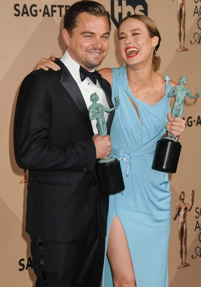 Leonardo DiCaprio and Brie Larson pose for photos together at the Screen Actors Guild Award
