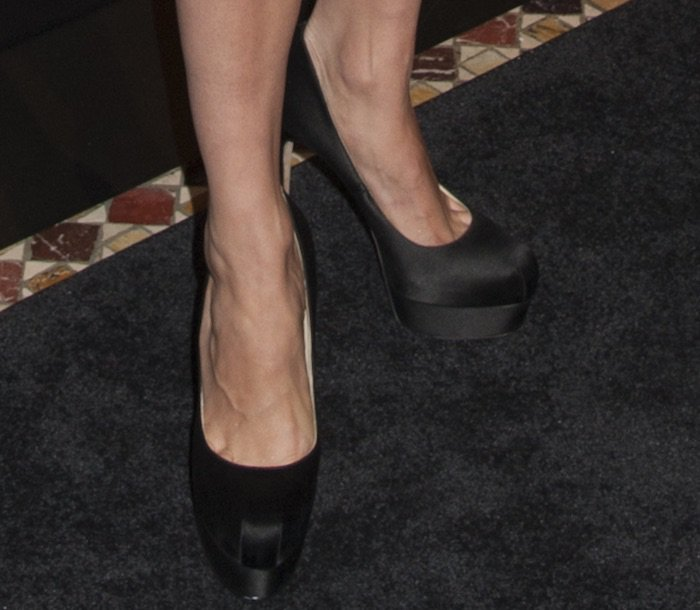 Brie Larson's feet in black satin Brian Atwood pumps