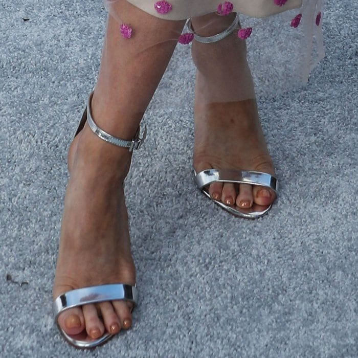 Brittany Snow showed off her feet in silver metallic ankle-strap sandals