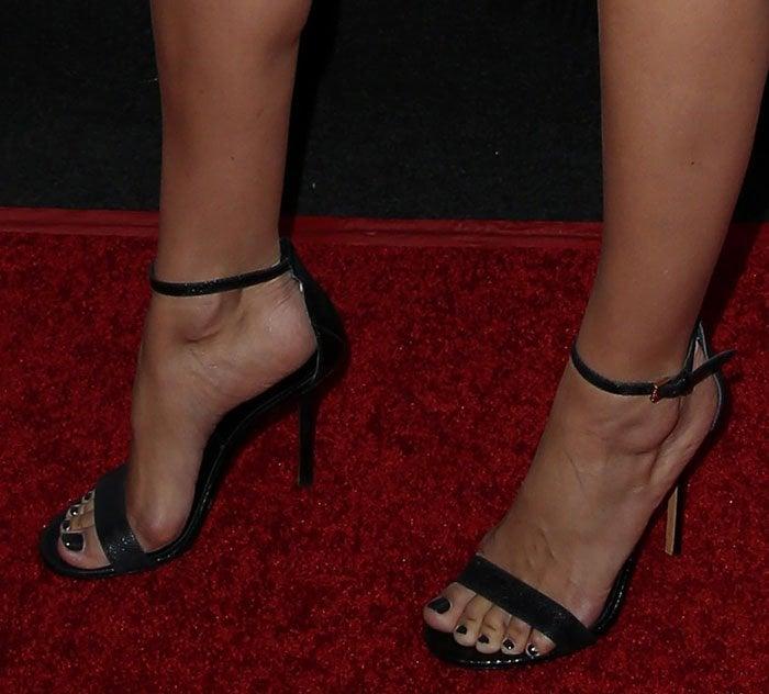 Camilla Belle's feet in simple black sandals