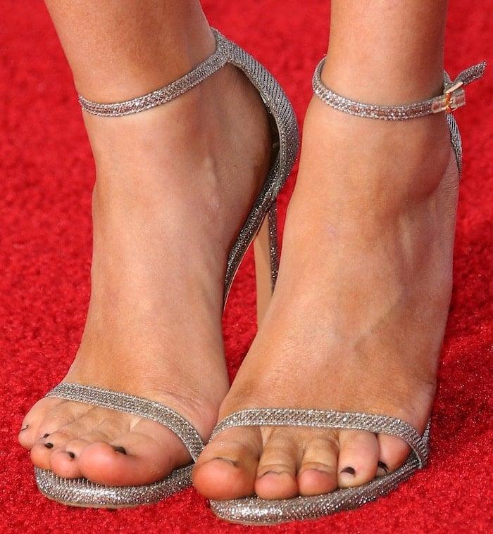 Camilla Luddington's feet in silver Stuart Weitzman sandals