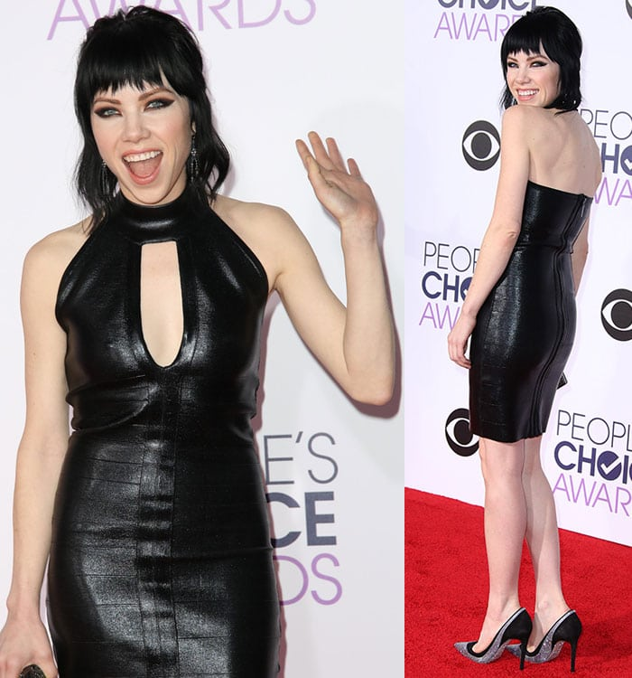 Carly Rae Jepsen smiles and waves in a gothic vampy look on the red carpet of the People's Choice Awards