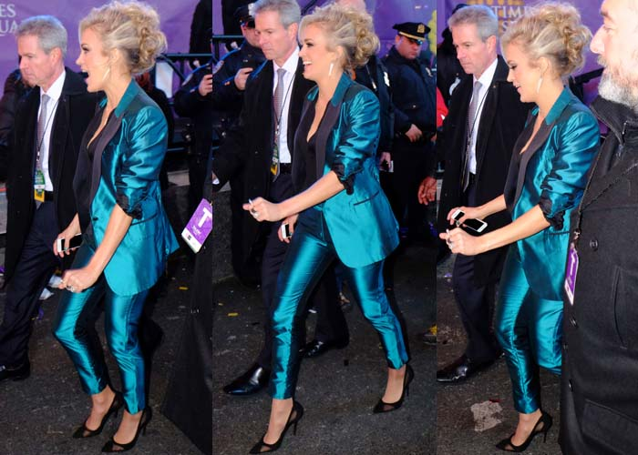 Carrie Underwood wears a metallic blue suit for New Year's Eve