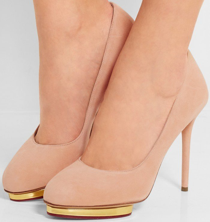 This pair is crafted from supple suede and finished with the label's signature gold island platform for stability