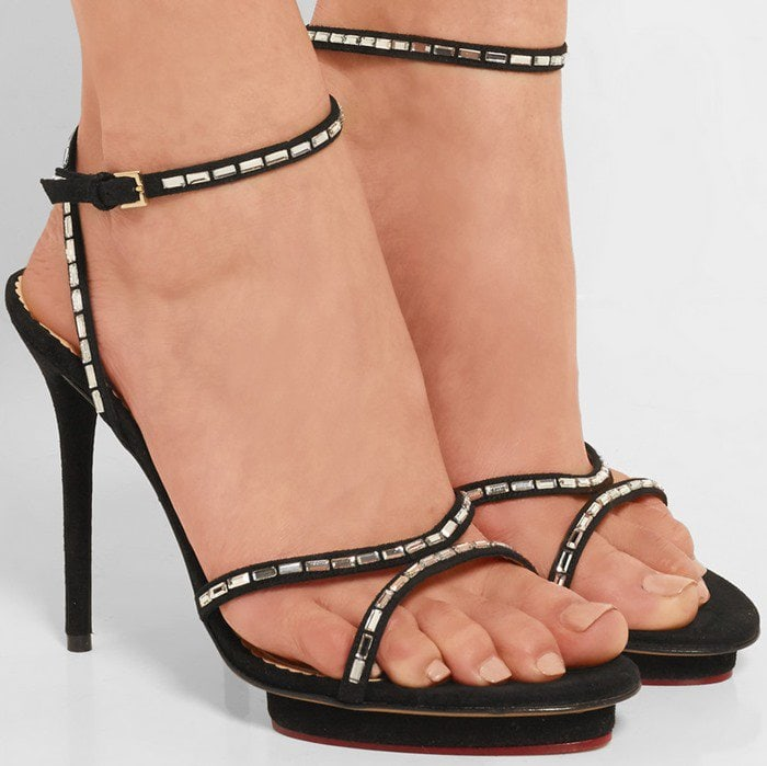 The slim suede straps of Charlotte Olympia's 'Evelyn' sandals are embellished with sparkling baguette crystals