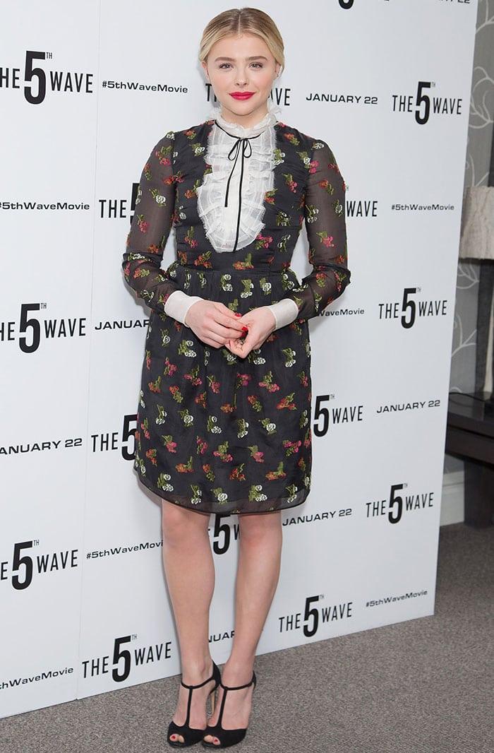 Chloe Moretz poses for photos in a floral-print Erdem dress